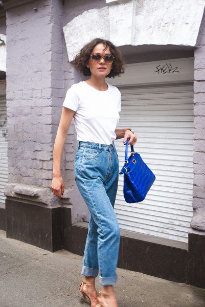 white t shirt with mom jeans and royal blue leather handbag