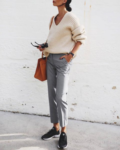 white v neck ribbed sweater with grey cropped chinos