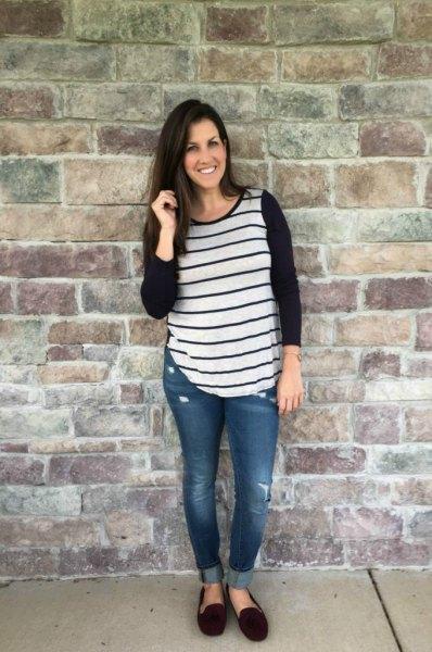 black and grey baseball long sleeve tee with cuffed skinny jeans