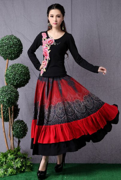 black and pink printed t shirt with red flared maxi skirt