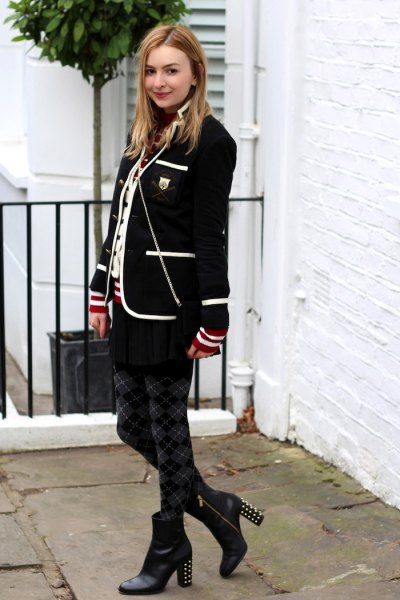 black and white golf jacket with tunic top and printed leggings