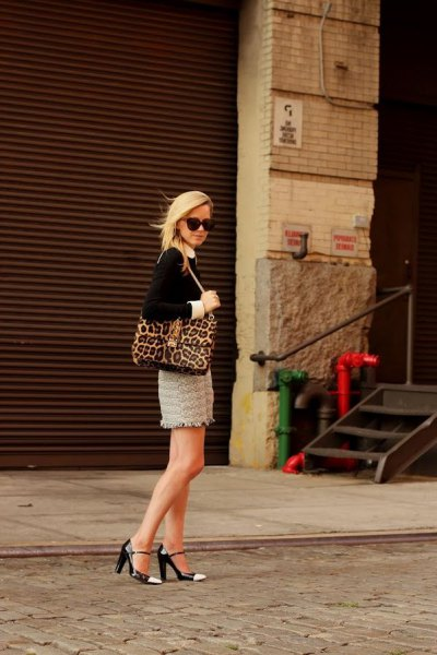 black blouse with leopard print purse and pink mini lace skirt