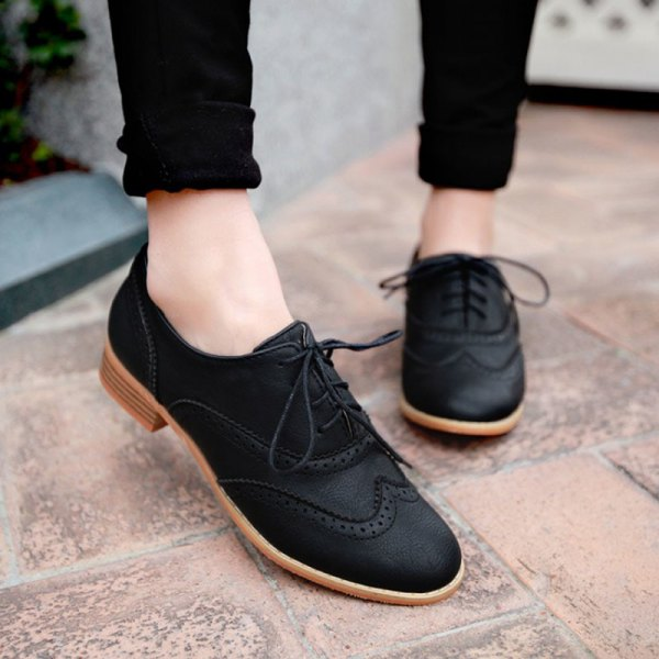 black cuffed skinny jeans with matching suede wingtip shoes