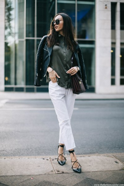 black leather jacket with grey button up shirt and white cropped jeans
