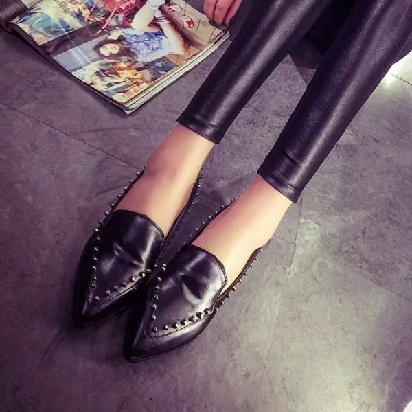 black leggings with matching studded wingtip shoes