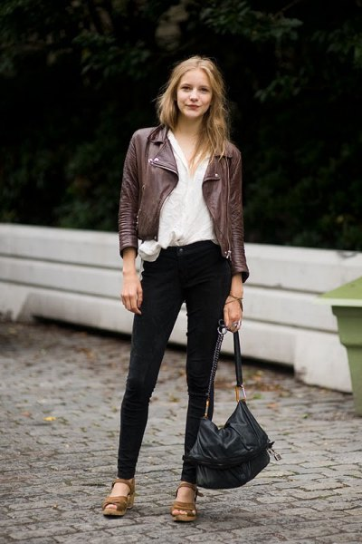 black moto jacket with white linen shirt and brown leather sandals