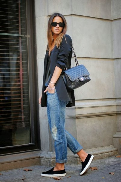 black oversized blazer with grey scoop neck t shirt and cuffed jeans