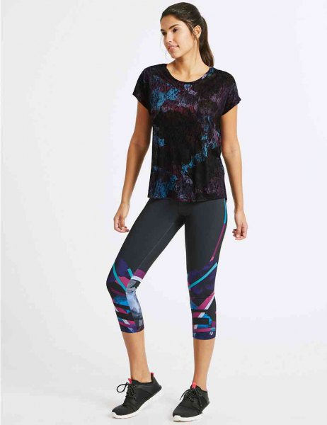 black printed tee with colorful cropped leggings