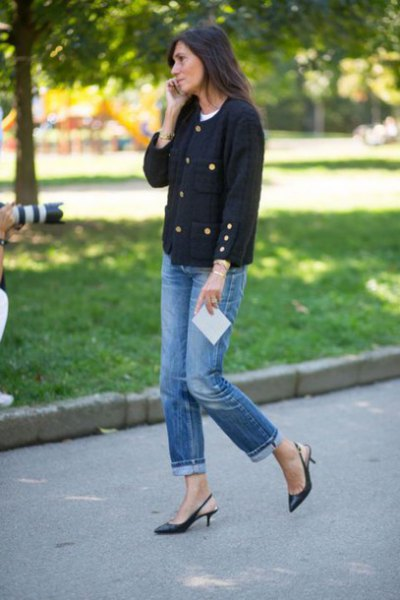 black sweater with blue cuffed jeans and kitten heels