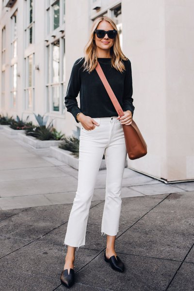 black sweater with white cropped jeans and brown leather shoulder bag