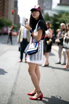black t shirt with white printed mini skirt and baseball cap