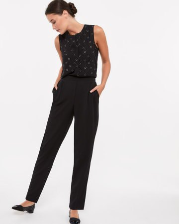 black tank top with slim fit pleated ankle jeans