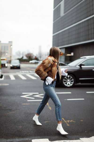 brown faux fur coat with grey skinny jeans