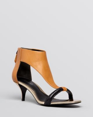 brown leather kitten heel sandals with black mini fit and flare dress