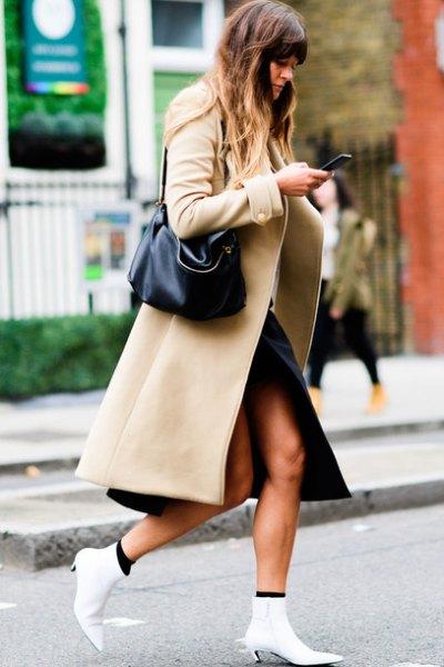 camel maxi wool coat with black side slit midi skirt