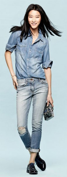 chambray shirt with blue ripped cuffed jeans