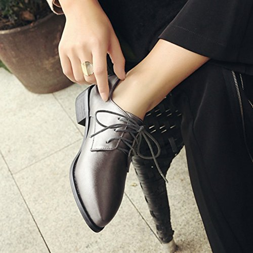 dark heeled leather shoes with black straight leg chinos