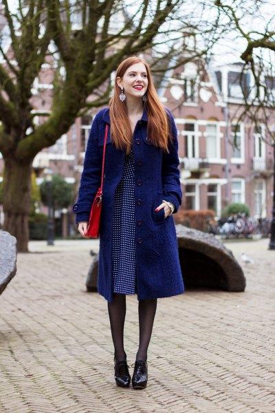 dark navy midi coat with blue polka dot dress