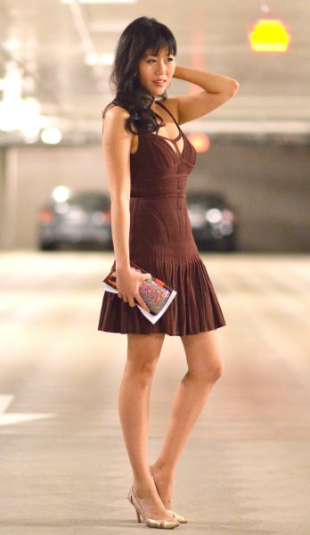deep v neck sleeveless fit and flare mini pleated dress with pink heels