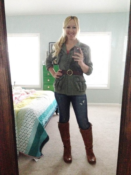 grey belted golf jacket with dark blue skinny jeans and brown leather knee high boots