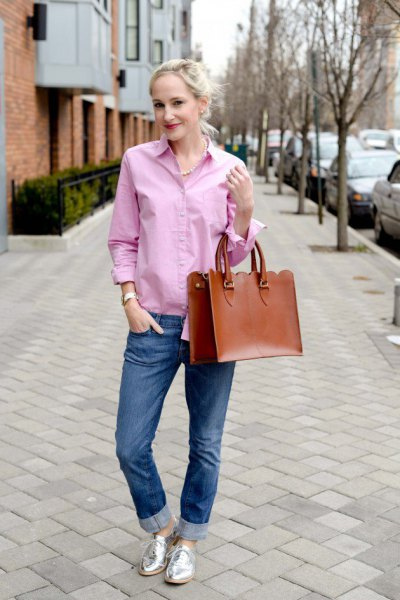 grey button up shirt with blue cuffed jeans and silver buck shoes