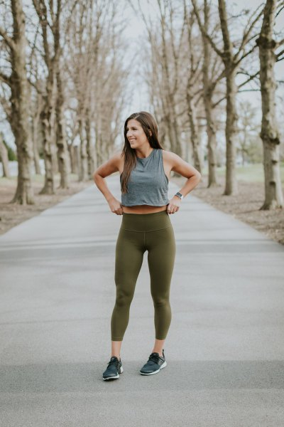 grey cropped tank top with green high waisted gym leggings