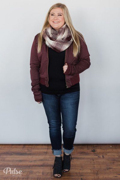 grey jacket with black sweater and cuffed dark jeans