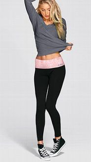grey long sleeve tee with black leggings and high top canvas shoes