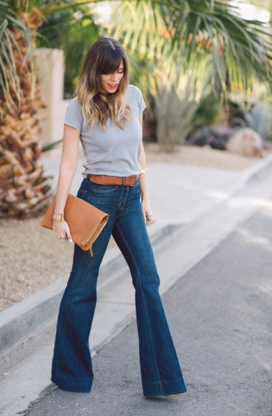 grey t shirt with blue belted high waisted flare jeans