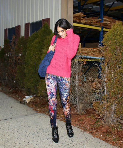 hot pink mock neck chunky knit sweater with painted jeans