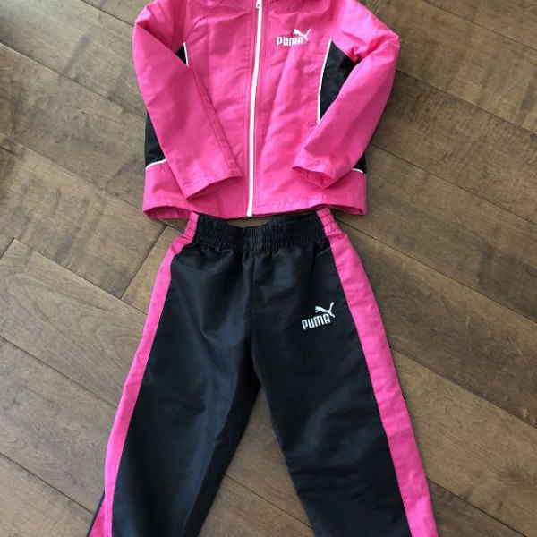 hot pink windbreaker with black running pants