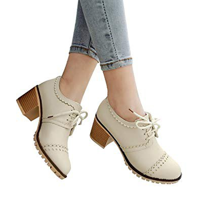ivory heeled wingtip shoes with light blue skinny cropped jeans