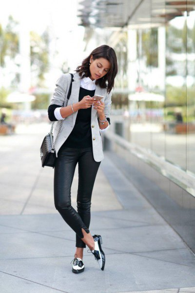 light grey blazer with dark blue skinny jeans and white buck shoes