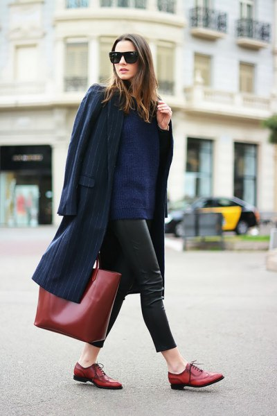 navy longline wool coat with leather leggings and brown leather buck shoes