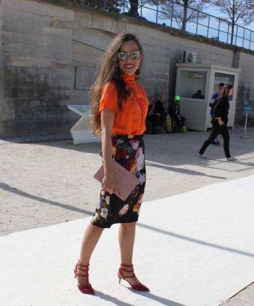 orange button up short sleeve shirt with black floral midi skirt