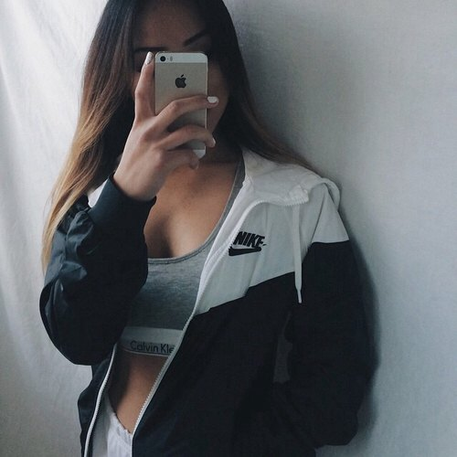 oversized windbreaker with grey spots bra top and white running shorts