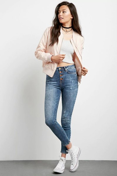 pale pink bomber jacket with white cropped tank top