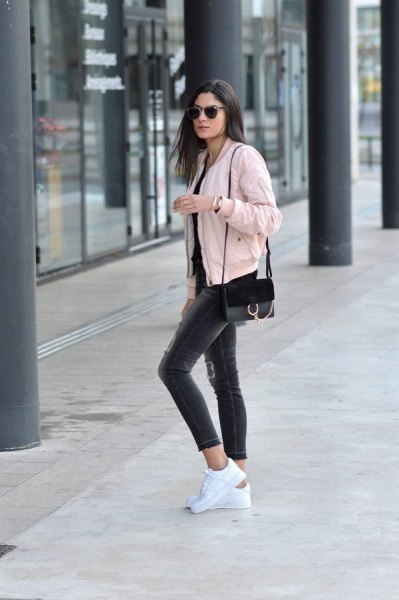 pale pink short bomber jacket with black cropped skinny jeans
