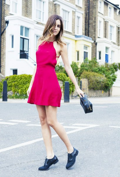 pink fit and flare mini dress with black derby shoes