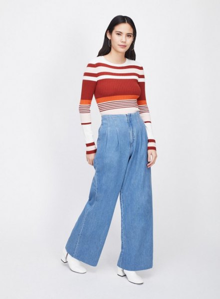 red and white color block sweater with light blue wide leg jeans
