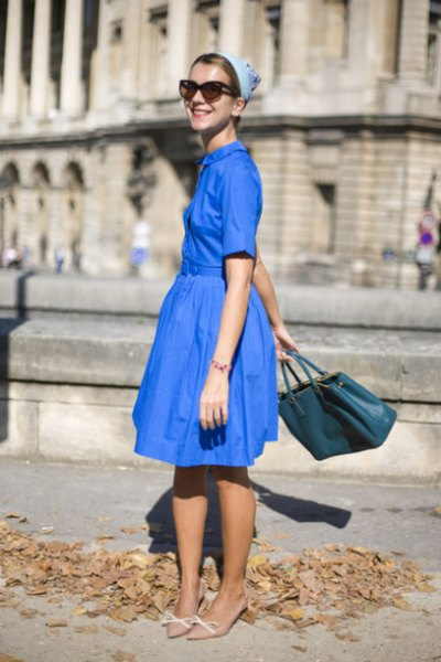 royal blue fit and flare midi dress with pale pink kitten heel pumps