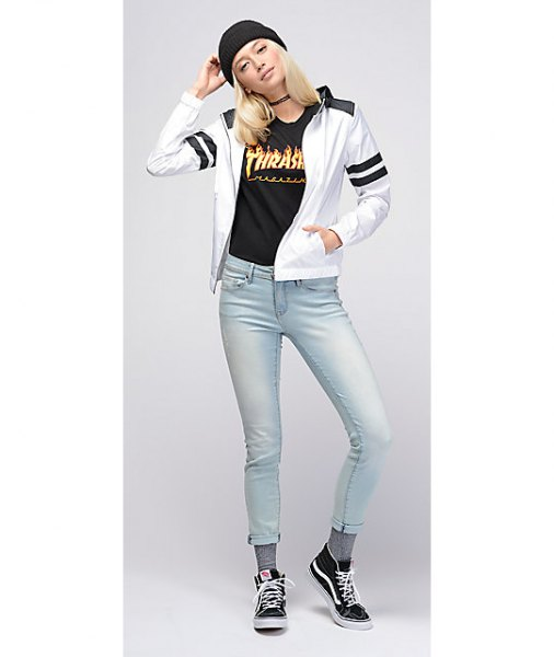 white and black windbreaker with super light blue skinny cropped jeans