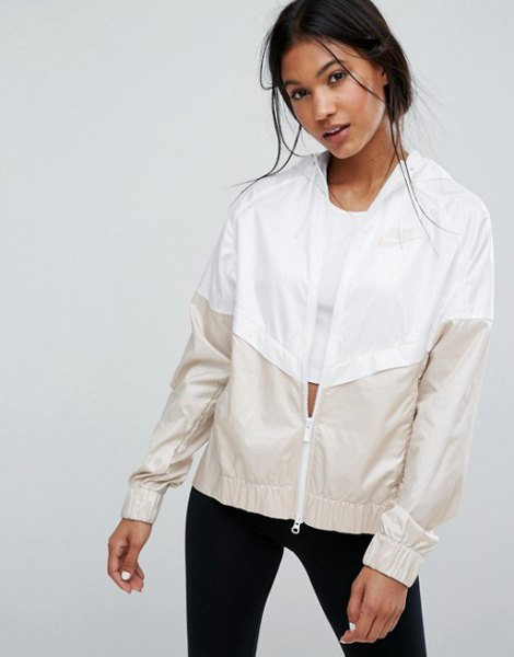 white and pale pink color block windbreaker with black skinny jeans