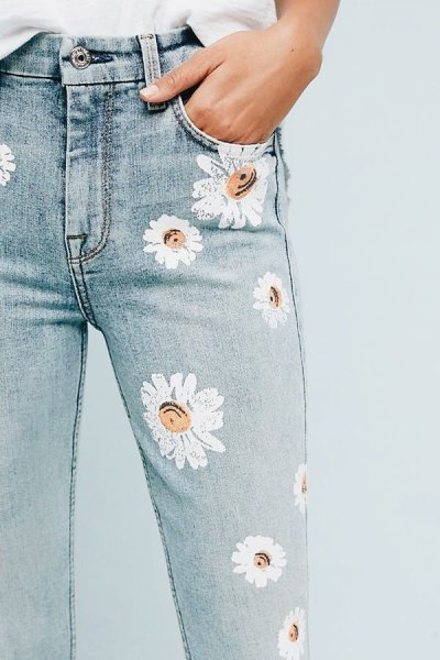 white blouse with light blue floral painted skinny jeans