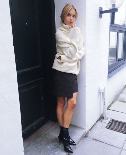 white chunky sweater with black mini wrap skirt and pointed toe kitten heel boots