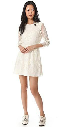 white fit and flare lace mini dress with wingtip shoes