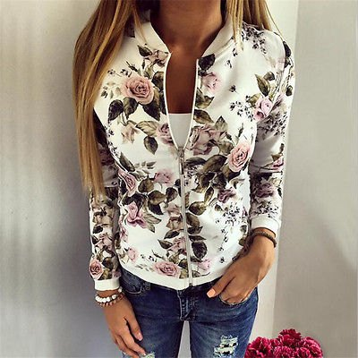 white floral printed running jacket with blue ripped skinny jeans