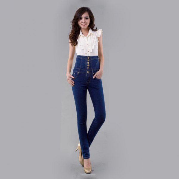 white sleeveless blouse with high rise button fly skinny jeans