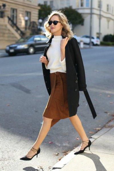 white sweatshirt with black wool coat and brown knee length skirt