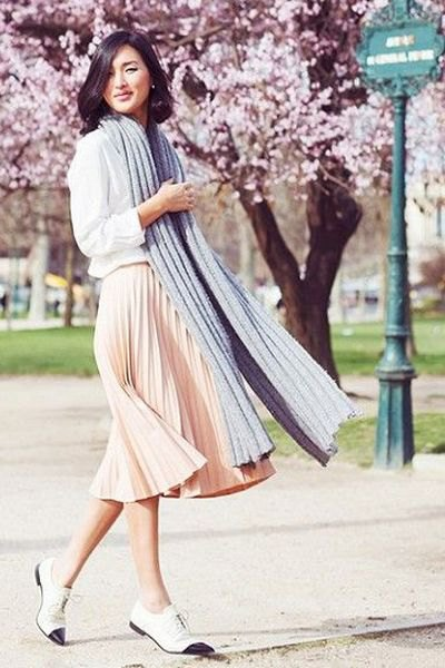 white sweatshirt with pale pink pleated midi dress and oxfords
